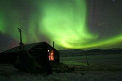 northern lights and cabin , image by Per Jessen